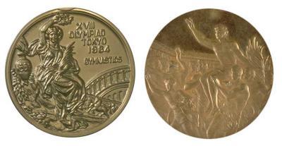 Медаль XVIII Летних Олимпийских игр.jpg