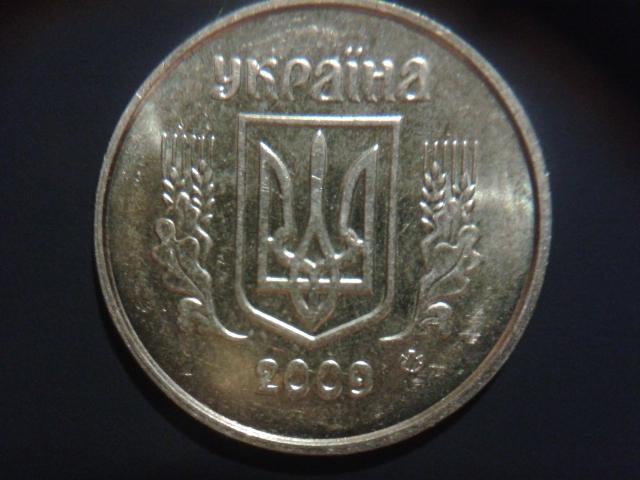 Украина 1 коп 2009 г новый орел на монетах